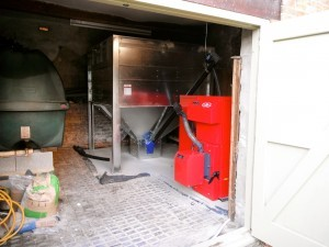 Domestic biomass boiler with fuel hopper