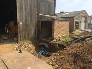 Wood fuelled boiler installation on a farm